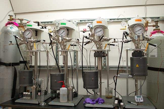 Catalytic conversion of biomass-derived chemicals to renewable polymers occurs in laboratory stirred-tank reactors. Credit: University of Minnesota.