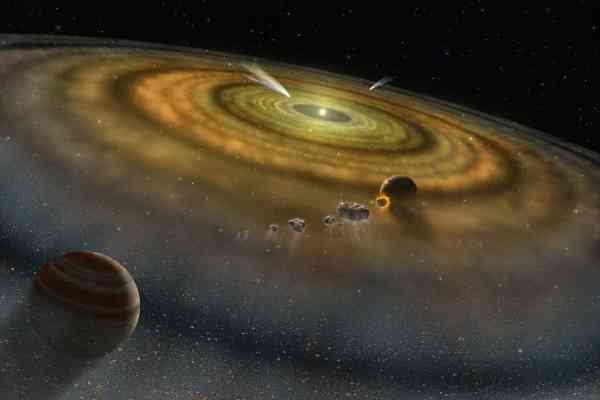Artist's conception of the dust and gas surrounding a newly formed planetary system. Credit: NASA.