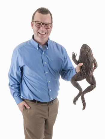 Herpetologist David Blackburn, shown with a Goliath frog from a collection housed at the Florida Museum of Natural History. Credit: Kristen Grace.