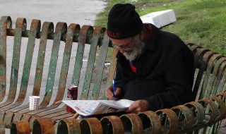 man solving crosswords