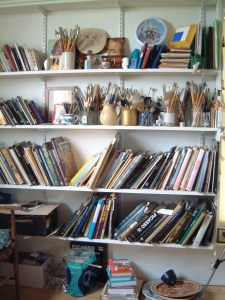Paint brushes and art books.