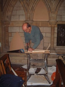 Carpenter Anthony Pascoe , making the painting supports.
