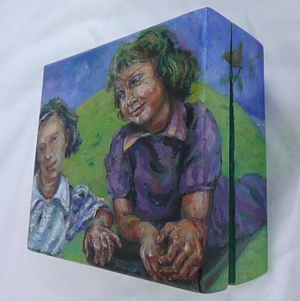 A painting on a wooden box of two friends playing with a hill and sky behind them it is all about friendship