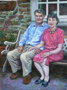 A realistic oil portrait of a husband and wife seated outside in the garden - to one side of them is the stonework of the house- behind them is a a window through it we see a teapot .