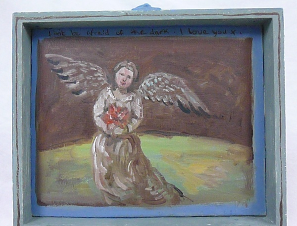 SHOPPING : painting .An Angel with wings out holds a bunch of flowers as a gift in a landscape.Painted on the inside of the lid of a wooden box the caption reads don't be afraid of the dark I love