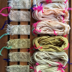 All yarns and lace close up.