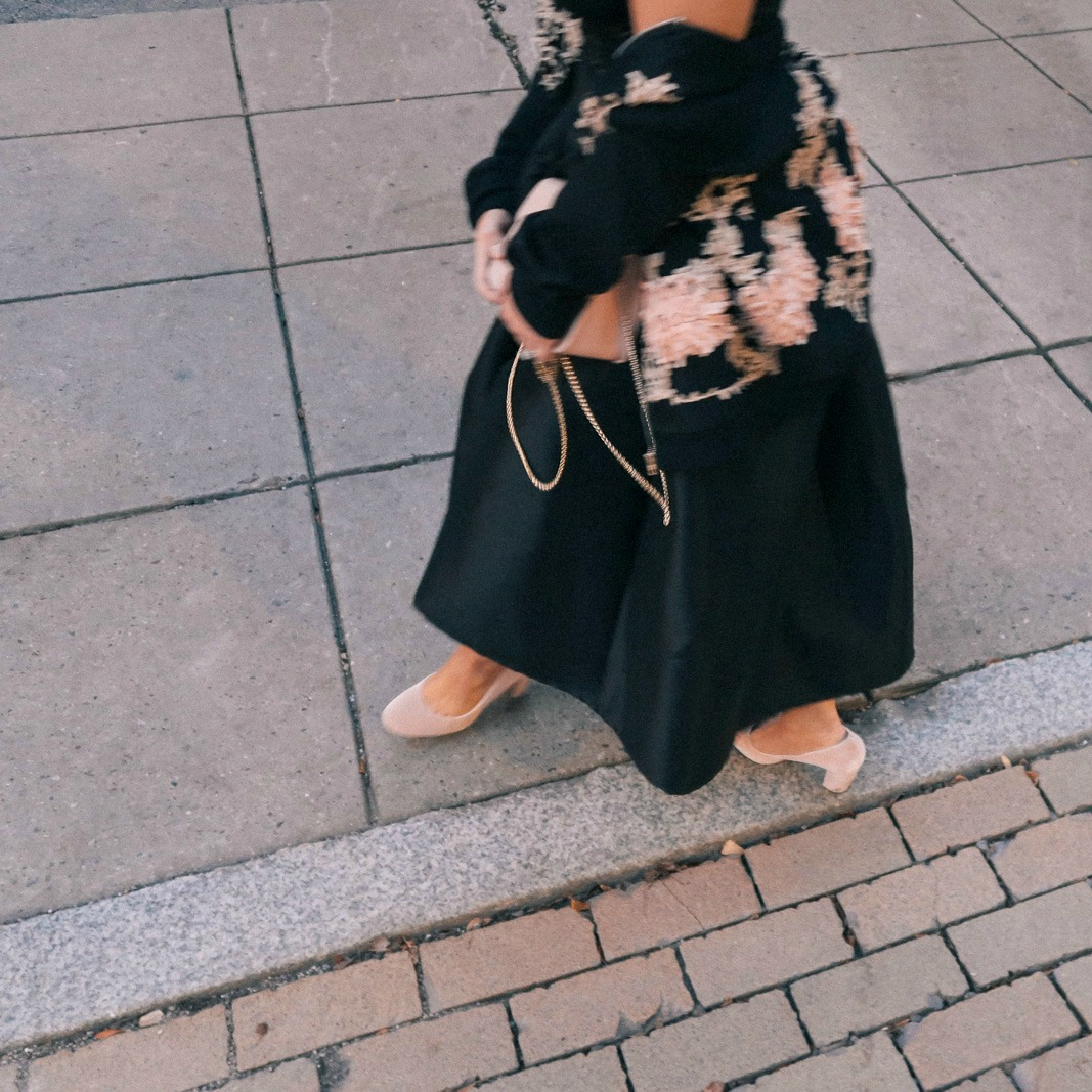 black bomber jacket with skirt