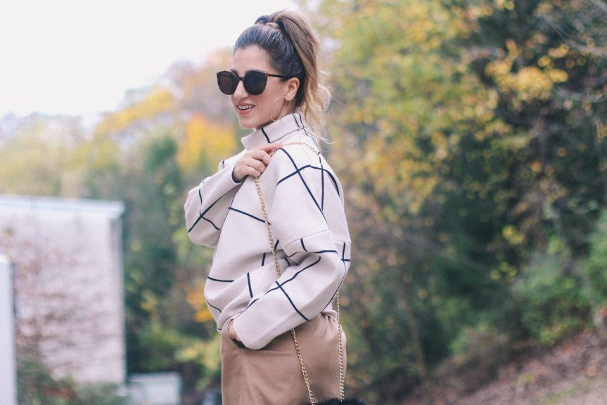 See how Zoe Namey of lifestyle blog Zoë With Love styles a classy fall outfit: grid print sweater, wool camel skirt, black over the knee suede boots