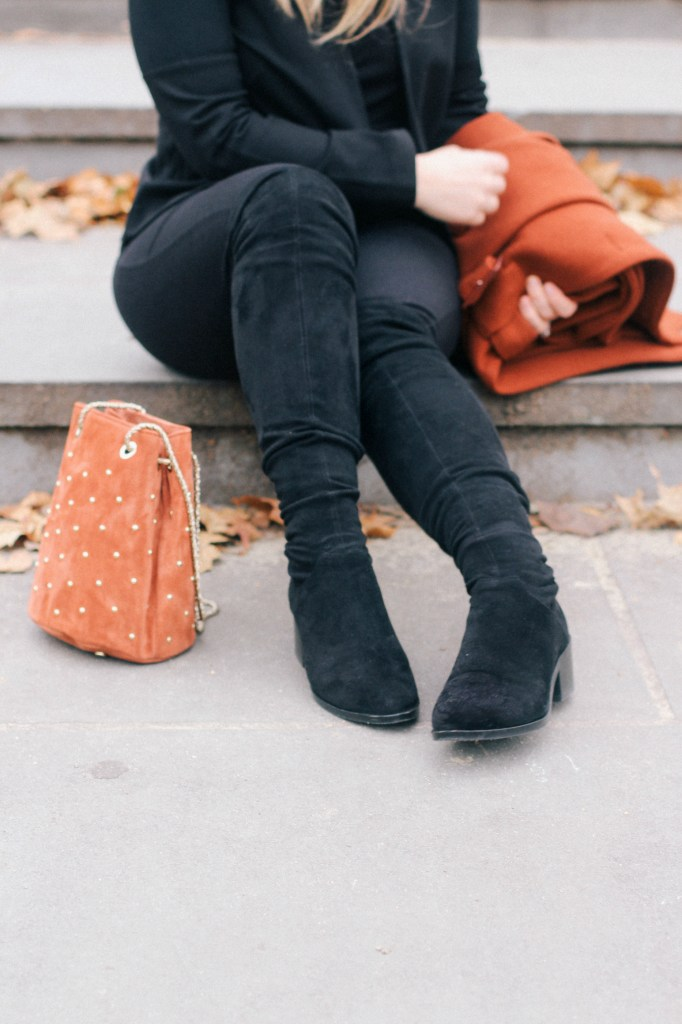 Zoe With Love styles a casual New Years Eve outfit featuring a Cape Coat, Sezane Bag, Black Beret