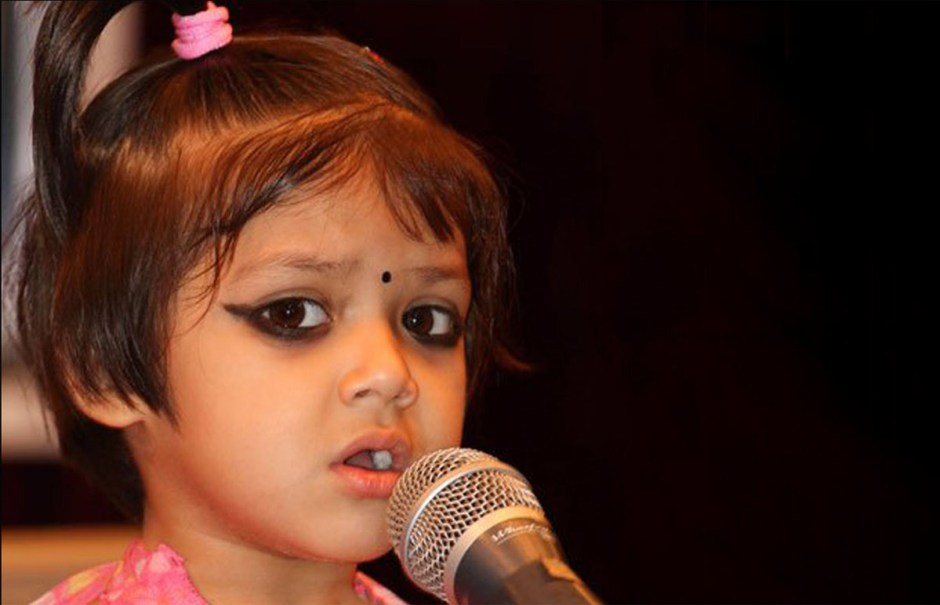 """AUGUST 2015   MUSIC   ATITHI GAUTAM -- Nepal's youngest singer Atithi Gautam K.C. ... at a concert in Kathmandu. The three-year-old sang the Nepali national anthem, accompanied by her sister Ushna K.C. in harmonium, with her father Uddhab K.C., who is a Nepali folk singer, sitting next to her during the concert. Although Romania's youngest singer Cleopatra Stratan holds a world record, """"No records have been found yet in Guinness Book of World Records of a child singer at this early age ..."""" so Atithi's father is in the process of recording Atithi's first album to submit for the world record."""