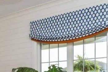 blue-white-geometric-fabric-orange-banding-faux-relaxed-roman-shades-Zona's-Drapery-House