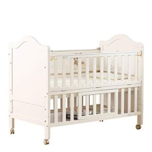 lit bébé Lit d'épissage multifonctionnel de lit de berceau de style européen en bois solide de bébé