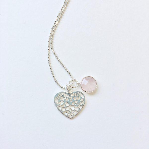 Lange ketting met edelsteen rozenkwarts hart bedel zilver