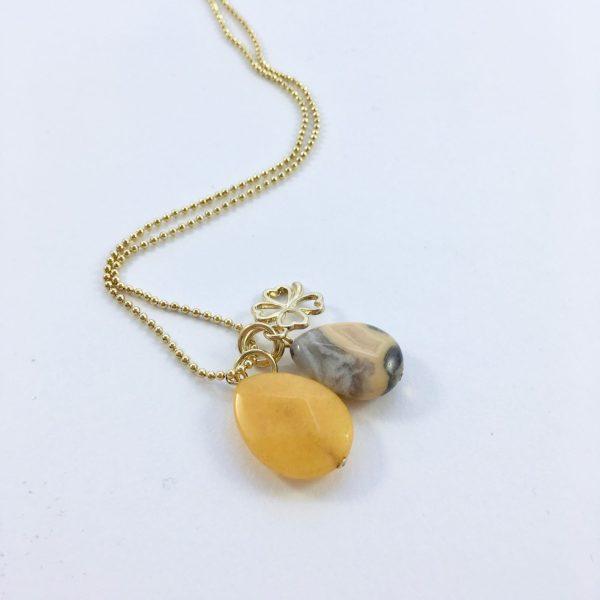 Lange ketting met gele jade en natuursteen klavertje vier goud
