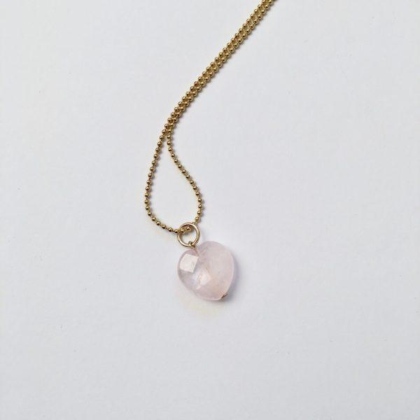 Lange ketting met rozenkwarts hart goud