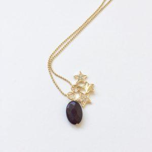 Lange ketting met zwarte natuursteen sterren bedel goud