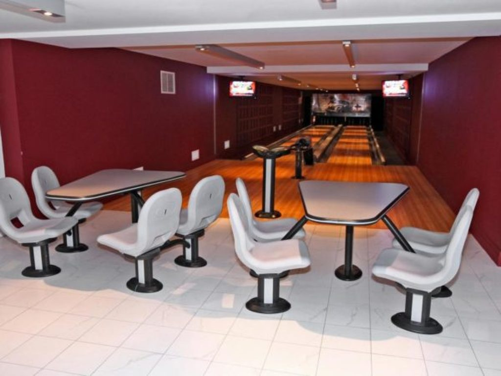 Wow your friends with a few rounds in this condo's bowling alley.