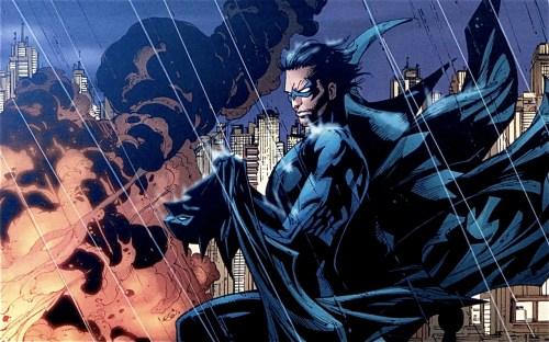 nightwing holding batmans cape