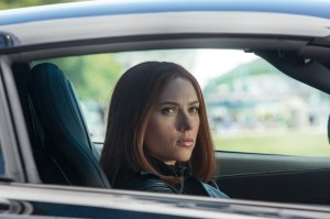 Black Widow in a sports car