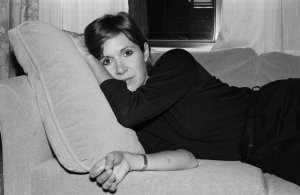 Carrie Fisher on a couch