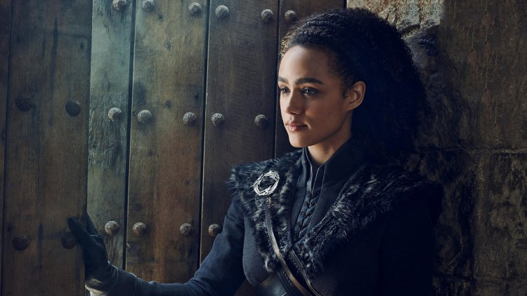 Missandei holding the door open