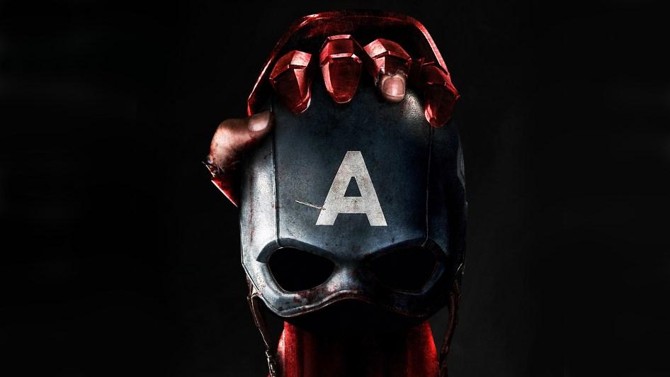 iron man holding captain america's helmet