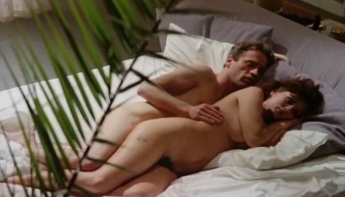 Serena Grandi nude topless bush full frontal oral and near explicit - Desiderando Giulia (1986) (12)