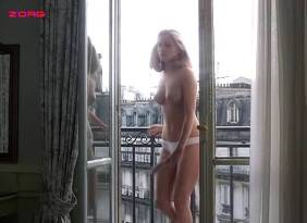 Emmanuelle Seigner nude topless - Détective (FR-1985)