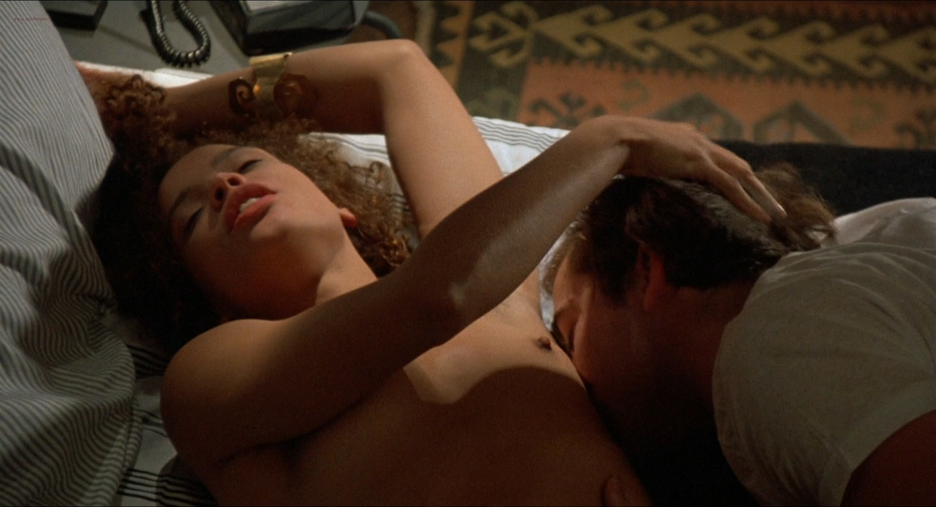 Jennifer Beals nude but covered and Kasi Lemmons nude topless - Vampire's Kiss (1989) hd1080p BluRay (7)