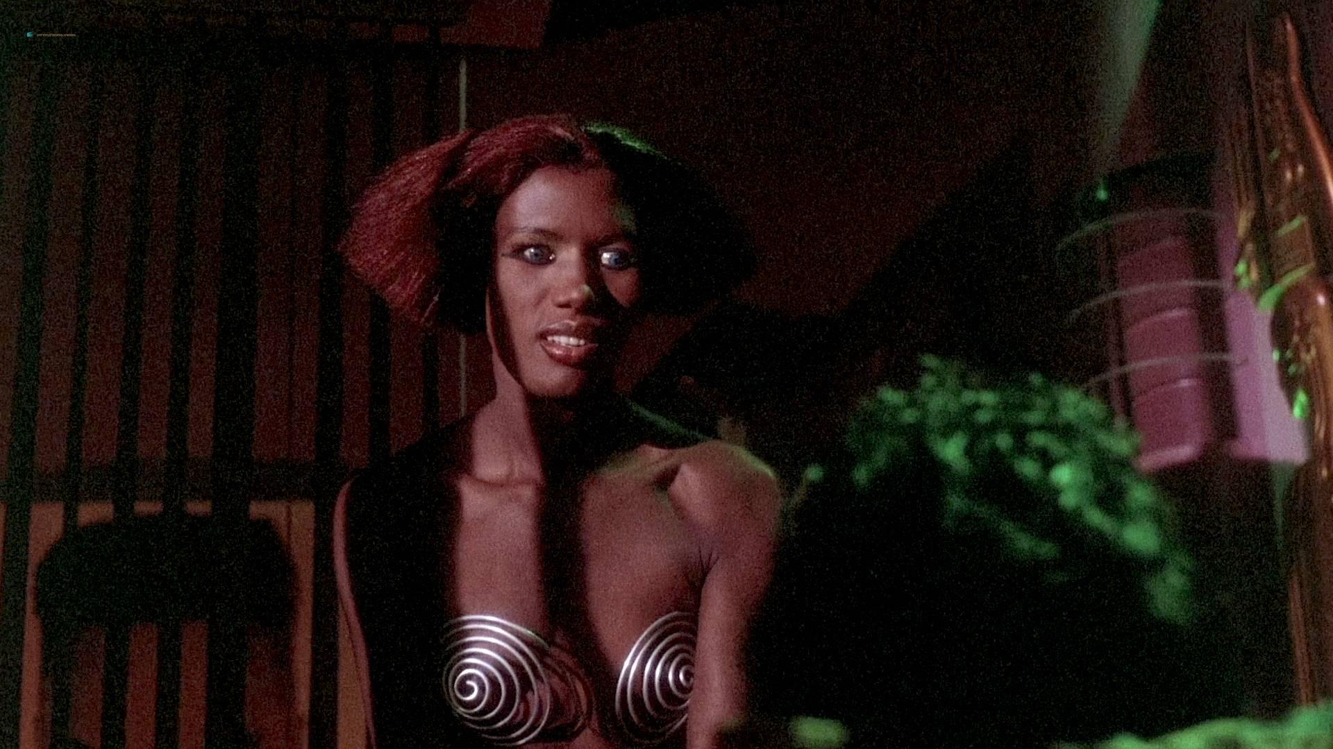 Grace Jones nude Lisa Lyon hot thong and Tricia Burns nude topless - Vamp (1986) HD 1080p BluRay (5)