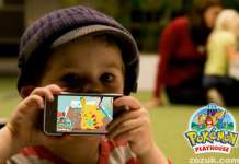 Kid playing Pokemon Playhouse game