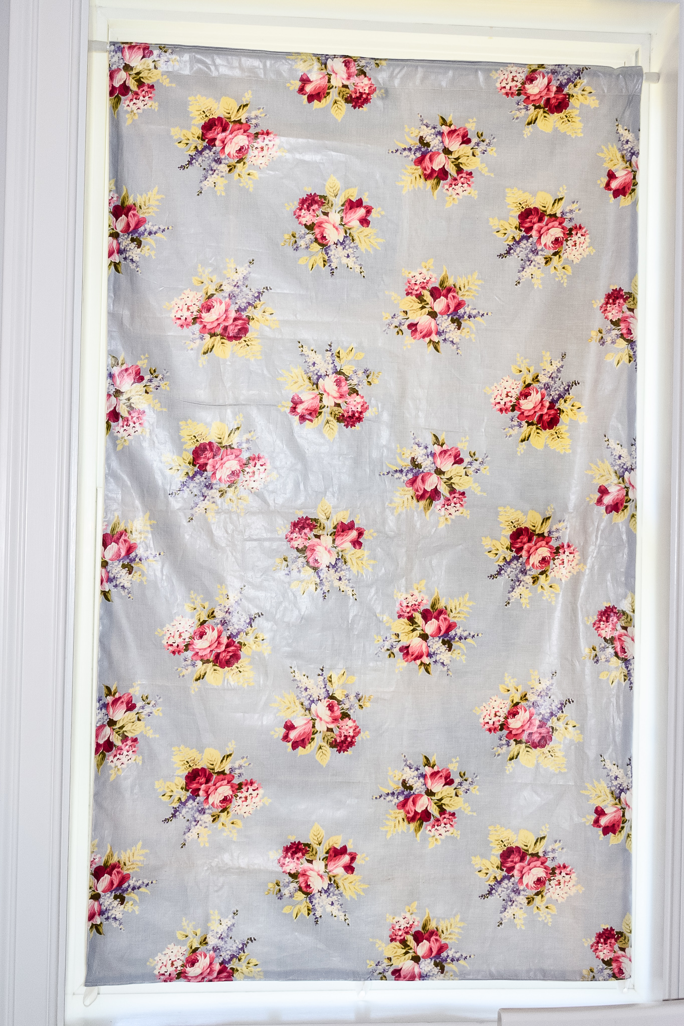 vintage floral shade covering up a window