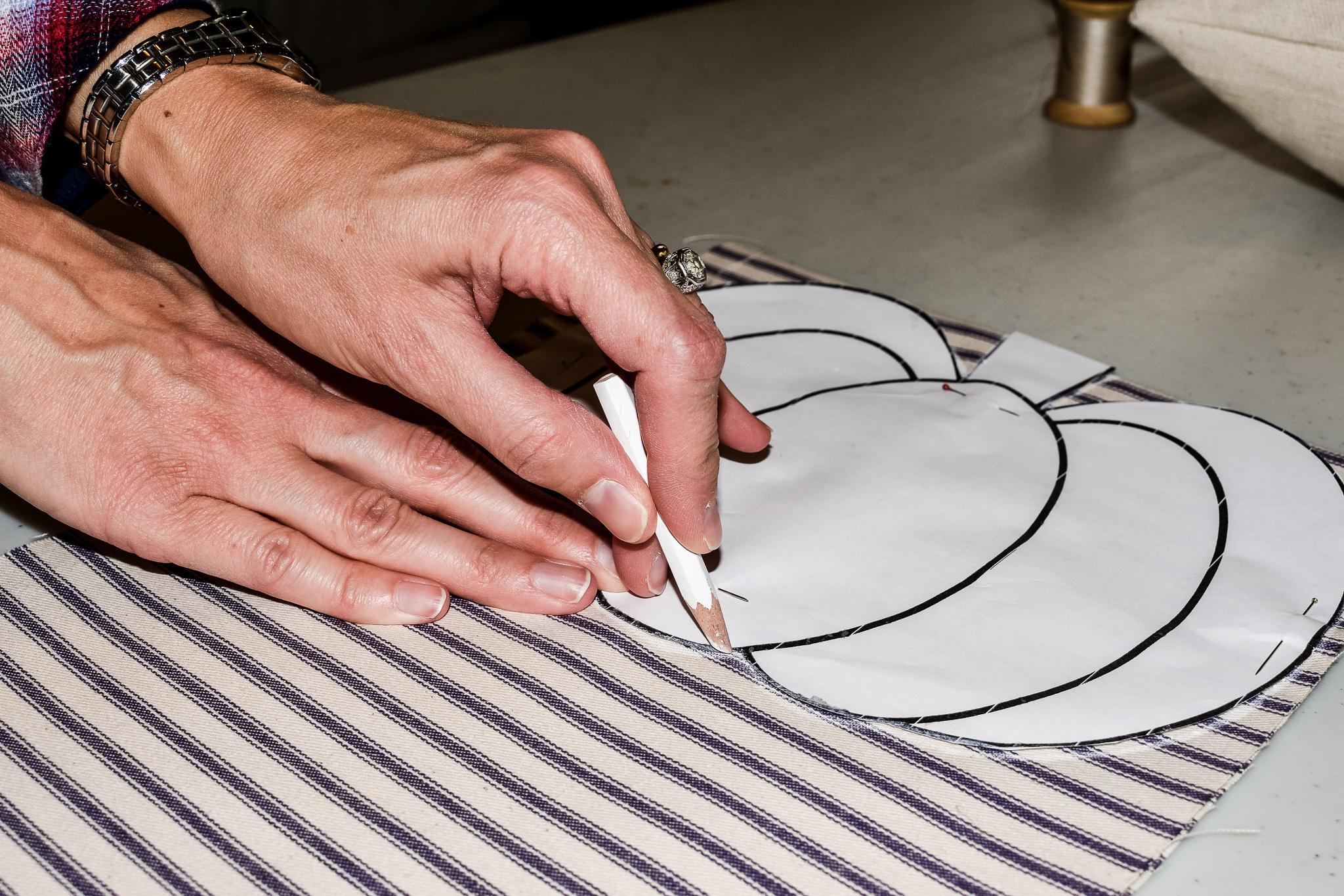 tracing a pumpkin template onto ticking fabric