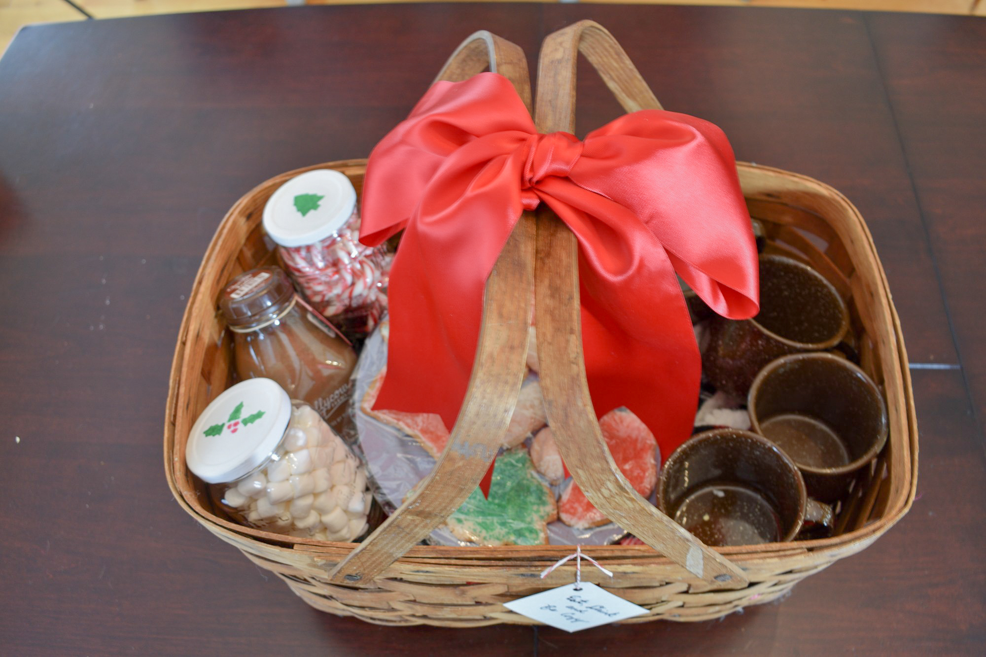 hot cocoa gift basket tied with a big red bow