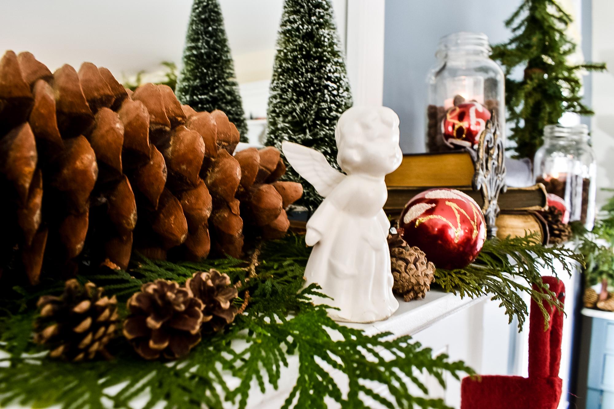 porcelain angel figurine on a Christmas mantel