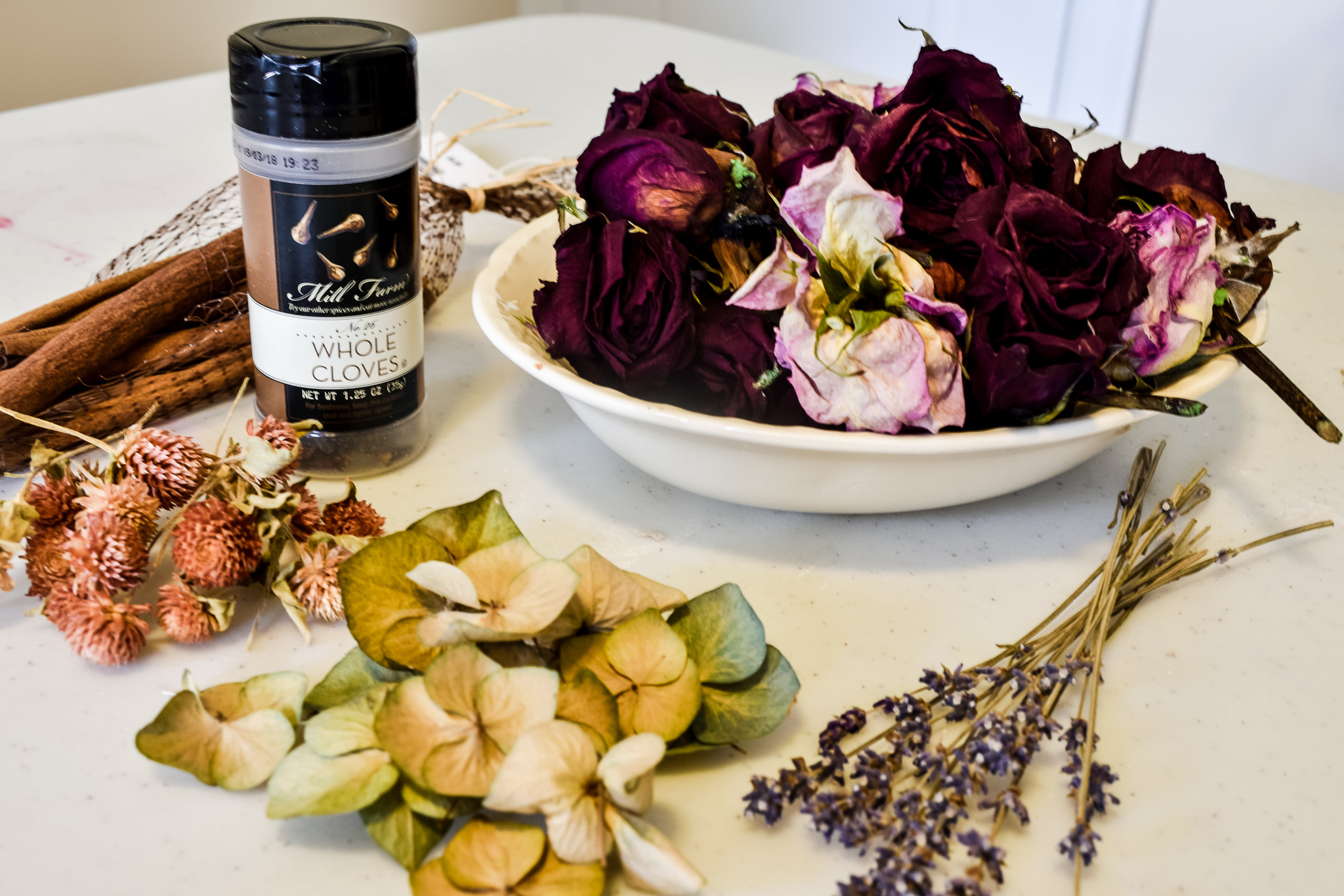 dried florals and spices needed to make a rose petal jar