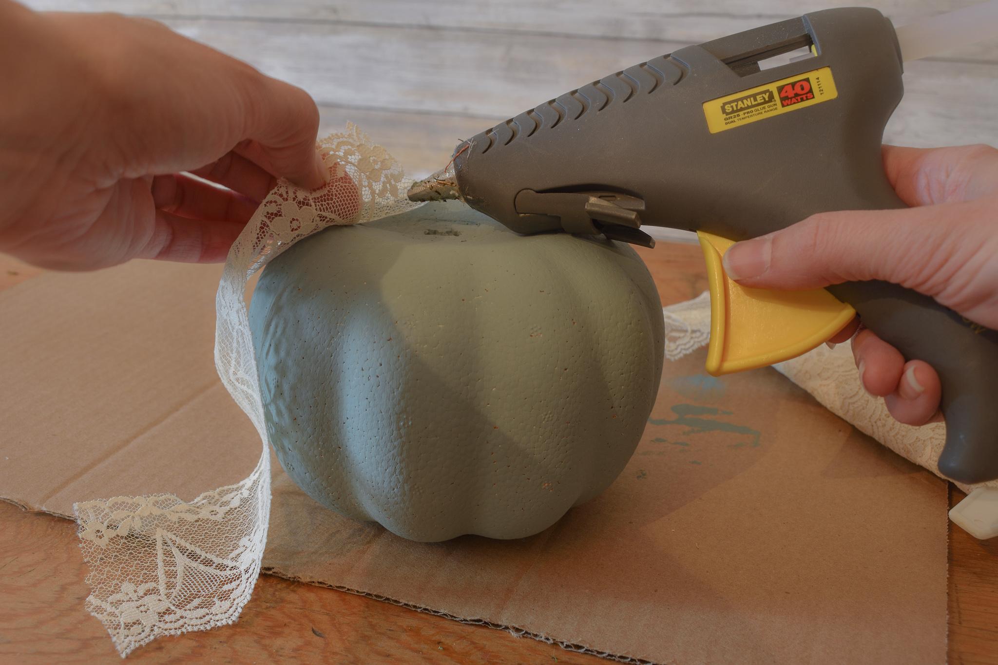 DIY Lace Pumpkins | zucchinisisters.com - Hot gluing lace onto DIY Lace Pumpkins. #zucchinisisters #dollartreedecor #lacepumpkins #falldecor