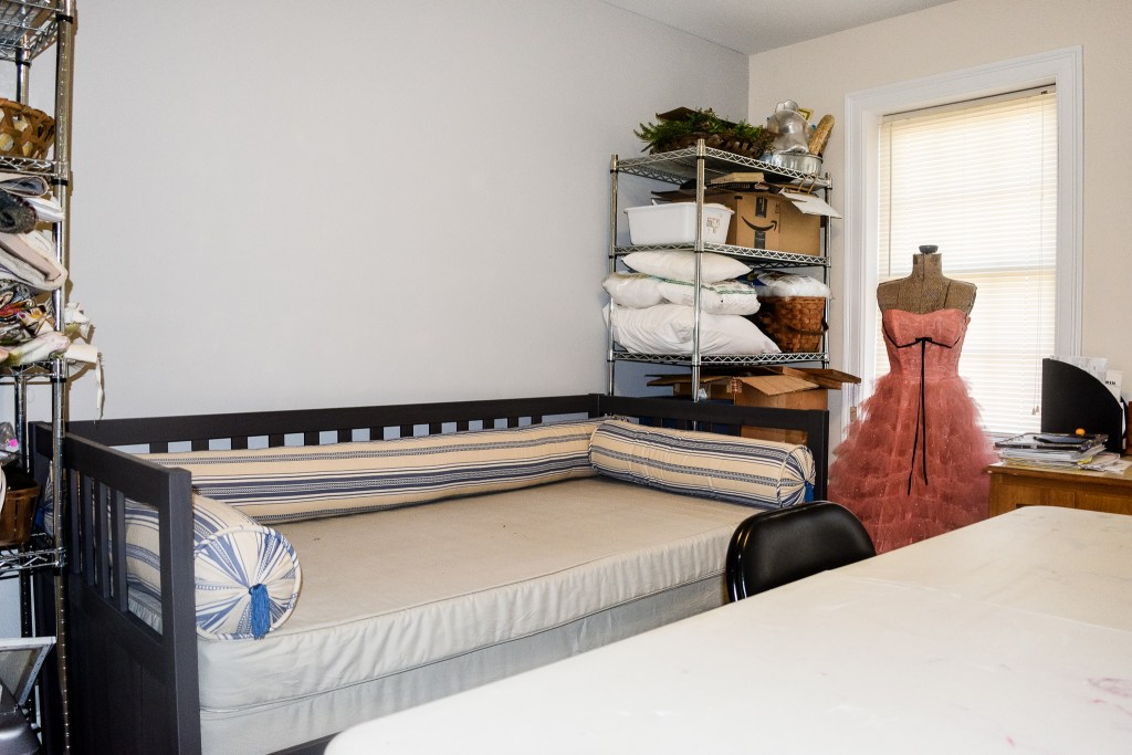 IKEA daybed with craft shelves on both sides