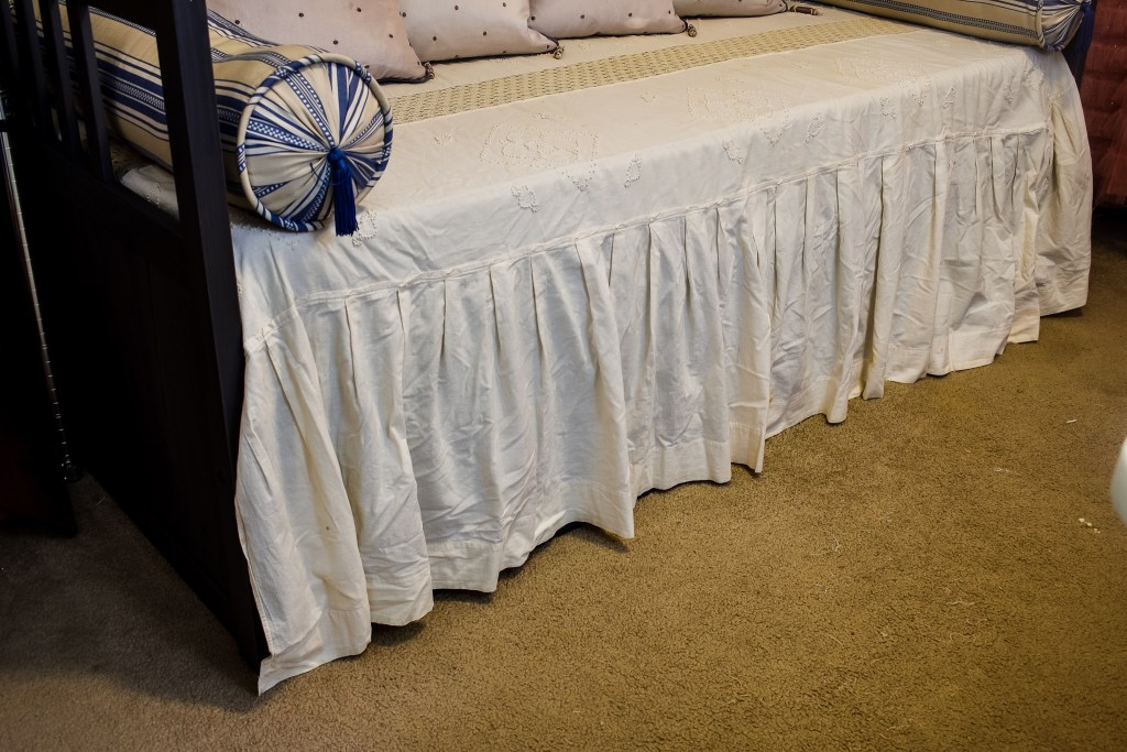 vintage off white bedspread on a daybed