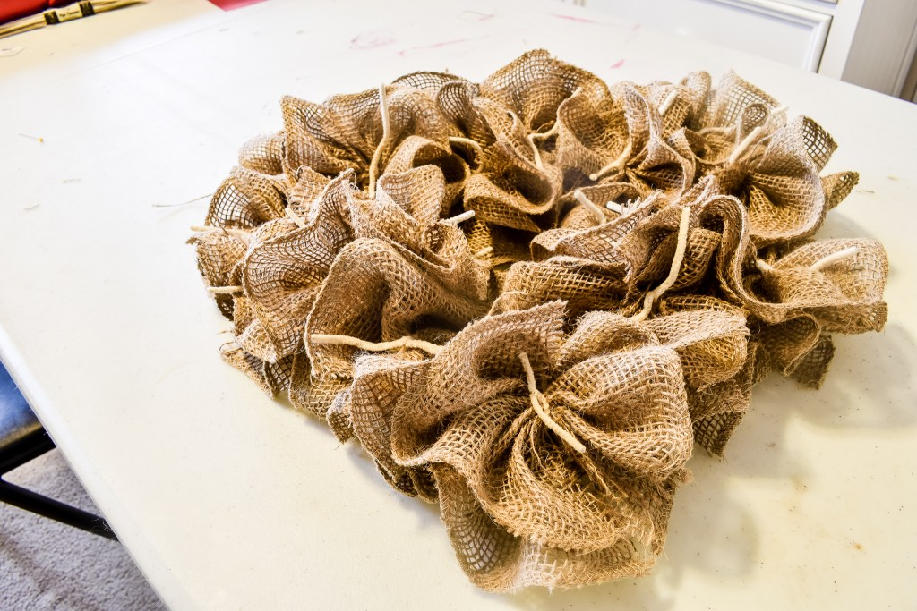 heart wreath form covered with burlap flowers to make a DIY burlap wreath