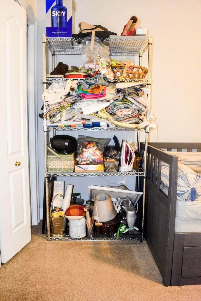 messy craft room shelves