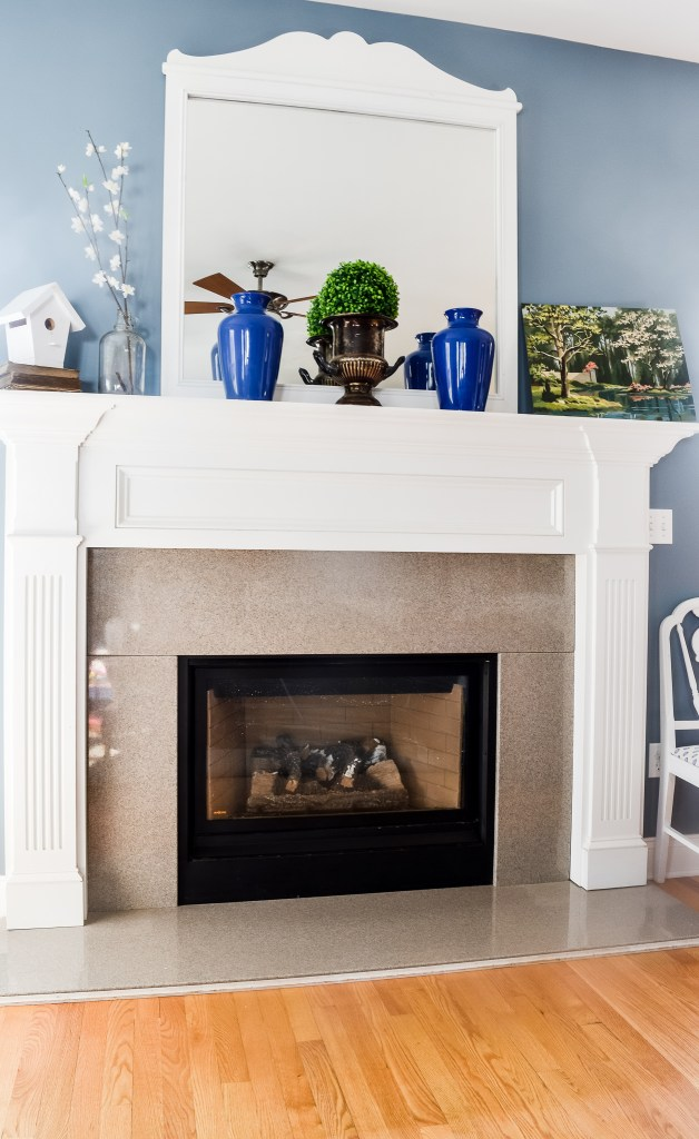 How to decorate a large mantel using tall items, artwork and faux florals