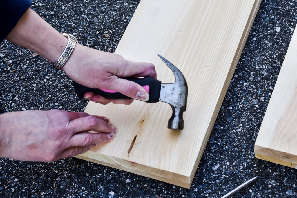 making dents and dings in a piece of new lumber to resemble older wood