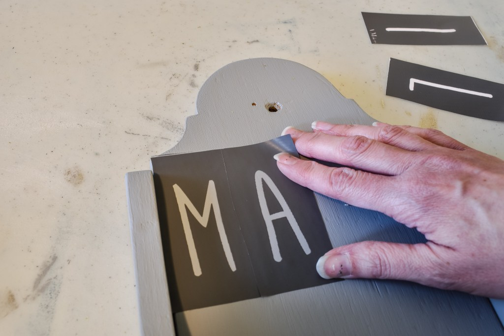 applying stencils to an upcycled mail holder
