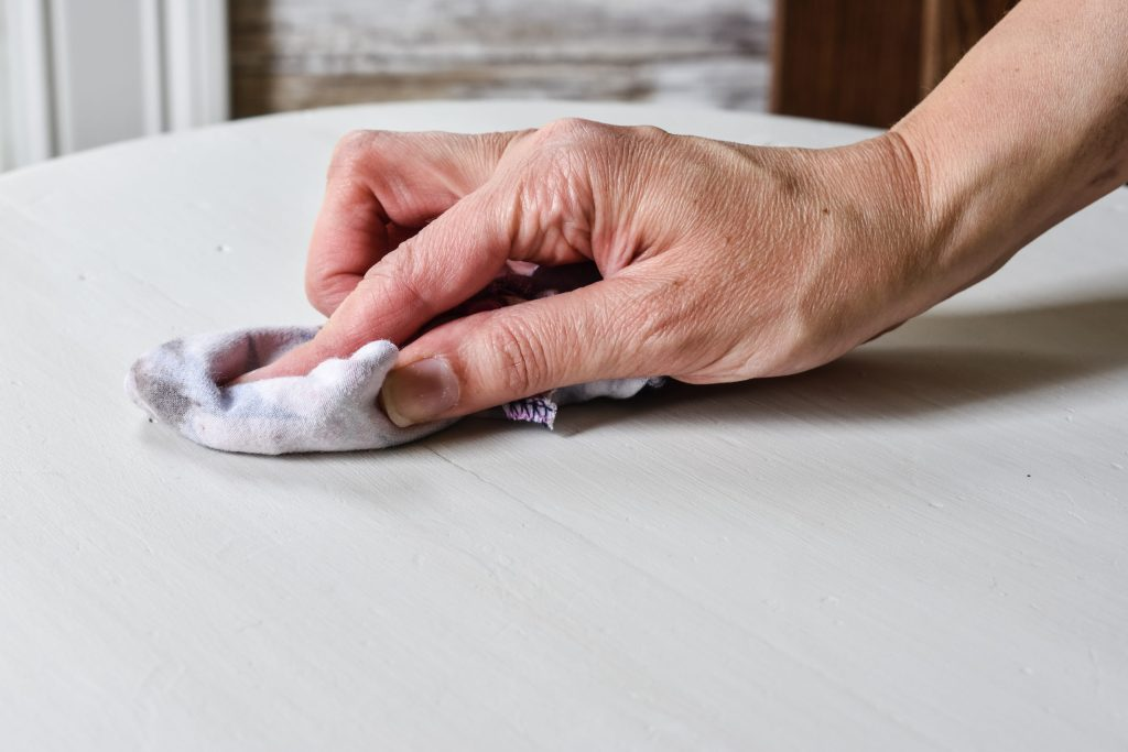 buffing off wax with a clean cotton rag
