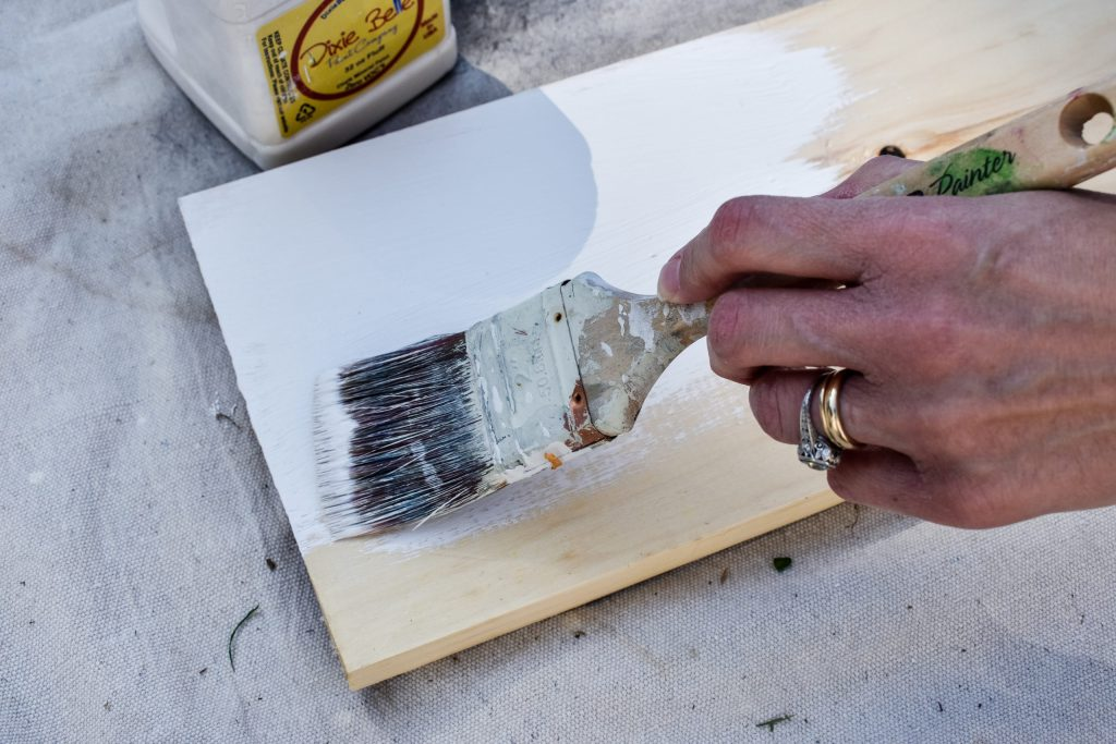 painting a wooden sign board white