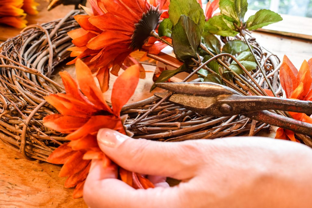 removing faux Dollar Tree sunflower stems from a bouquet