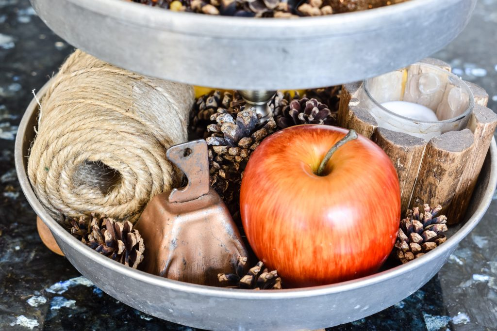 Jute twine, copper bell, apple, woodland candle and pinecones
