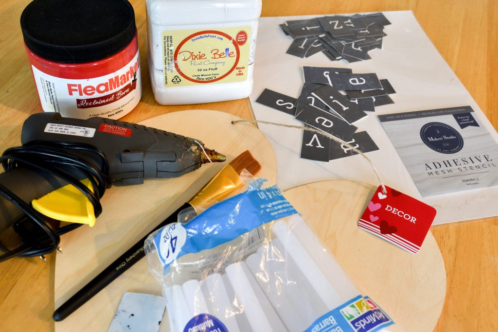 craft supplies needed to make a heart and puzzle piece wall hanger