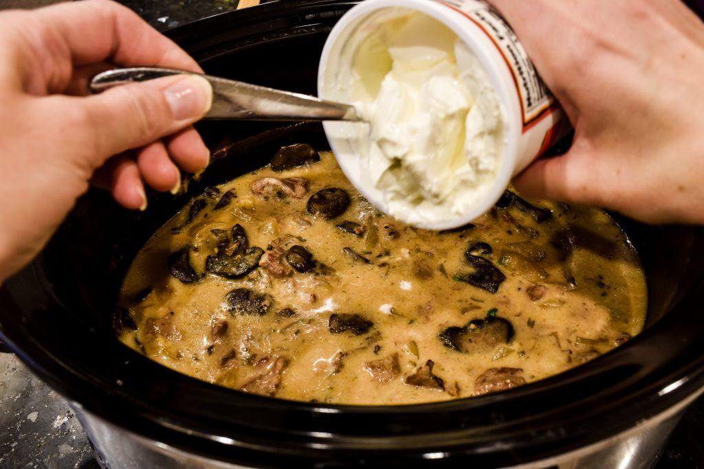 adding sour cream to a crock pot